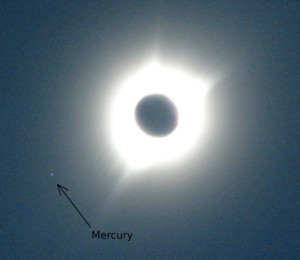 a picture showing Mercury next to the eclipes